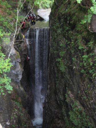 Abseiling down the waterfall